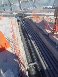 Laying vacuum pipes alongside other services